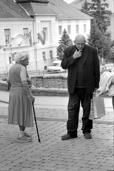 an old lady and a priest remembering